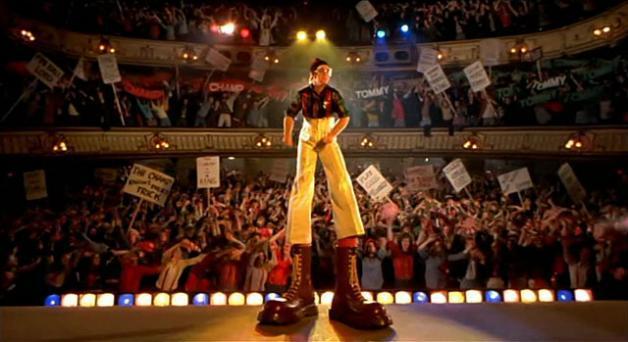 Elton John wearing giant dr Martens